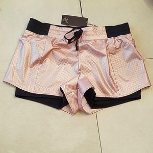 NWT Calia 2 in 1 rose gold shorts
